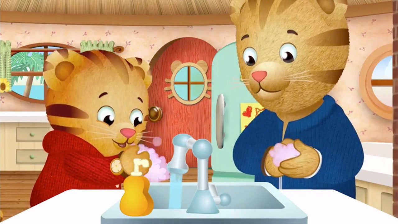 Daniel Tiger washing his hands with his mom.